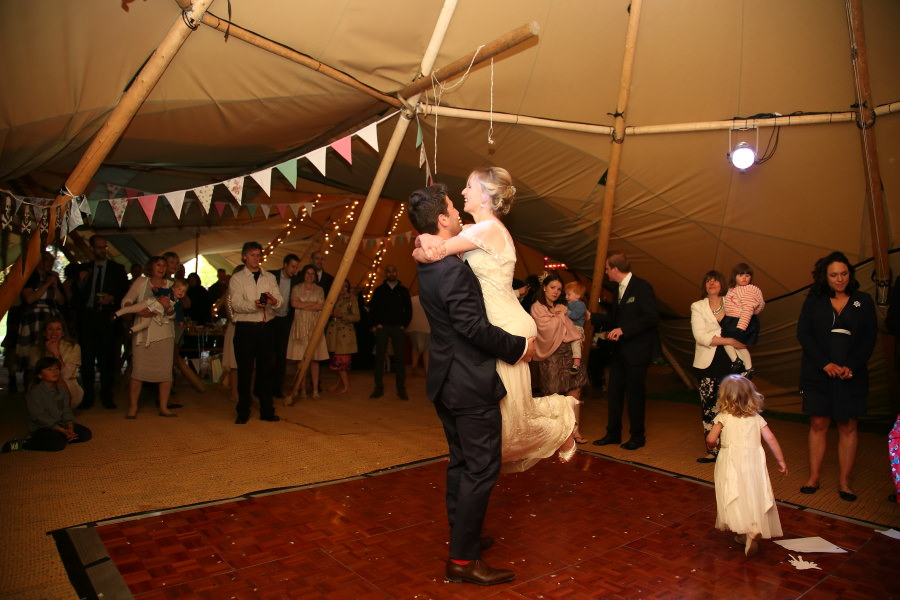happy couple at tipi wedding, first dance