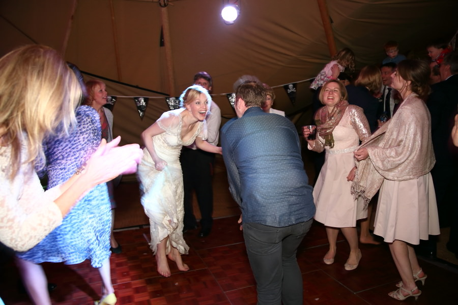 dancing at wedding reception in tipi