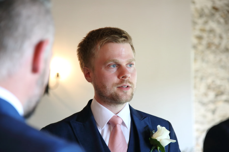 groom waiting for bride at the granary brans wedding, suffolk