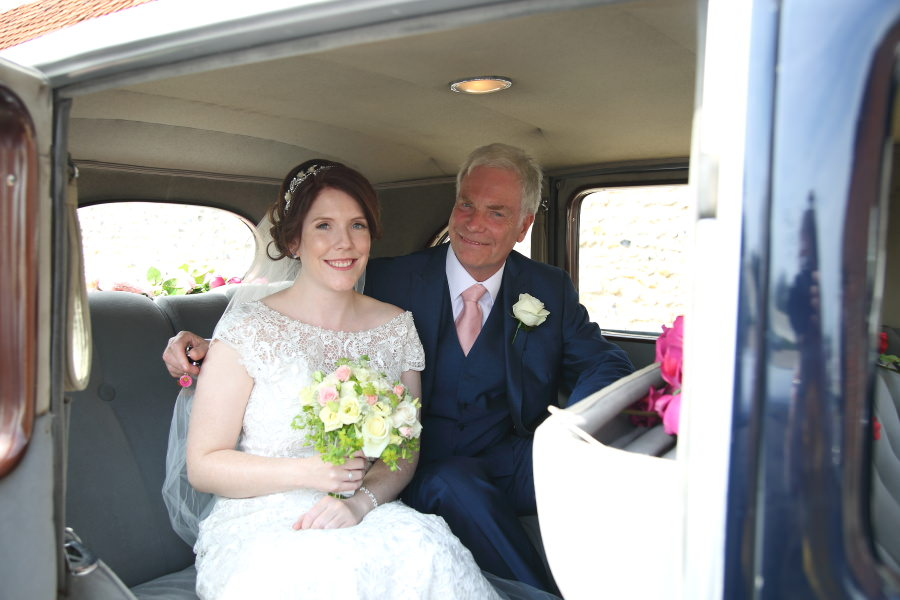 bride and father in wedding car, granary barns wedding, suffolk