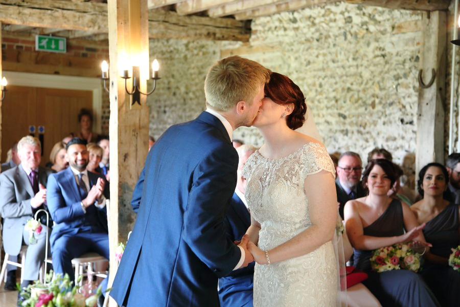 first kiss at the granary barns wedding suffolk