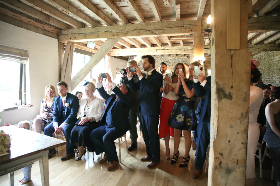 guests photographing the signing of the register, the granary barns suffolk