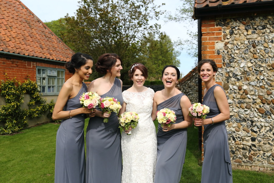 fun group shot with bridesmaids, the granary barns suffolk