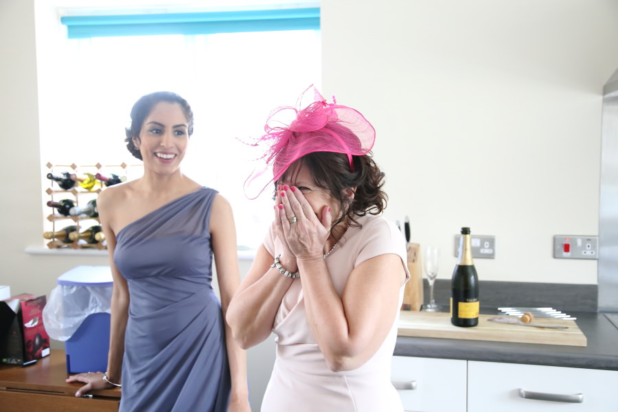 mother of the bride seeing daughter for first time on wedding day