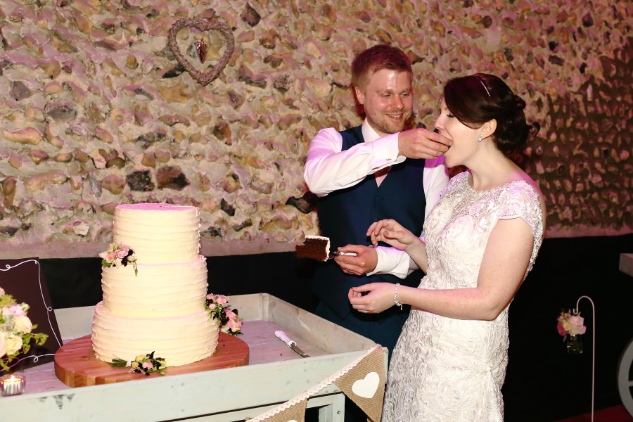 cutting the cake at the granary barns suffolk