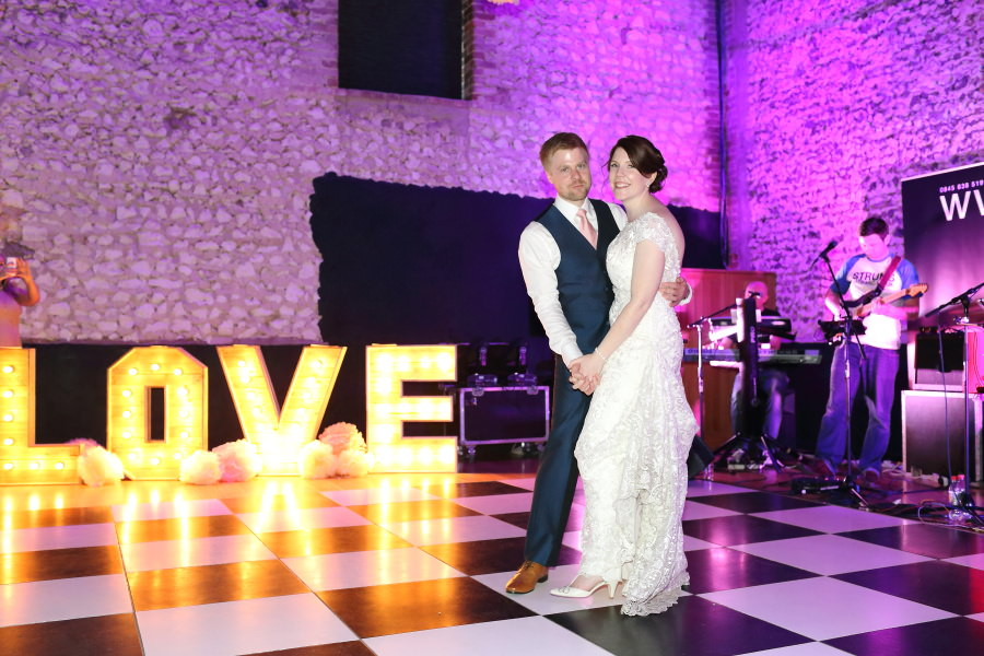 first dance at The Granary Barns, Newmarket Suffolk with large light up letters