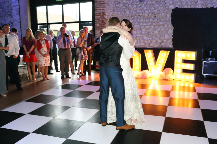 first dance huggs at The Granary Barns wedding, in Newmarket Suffolk