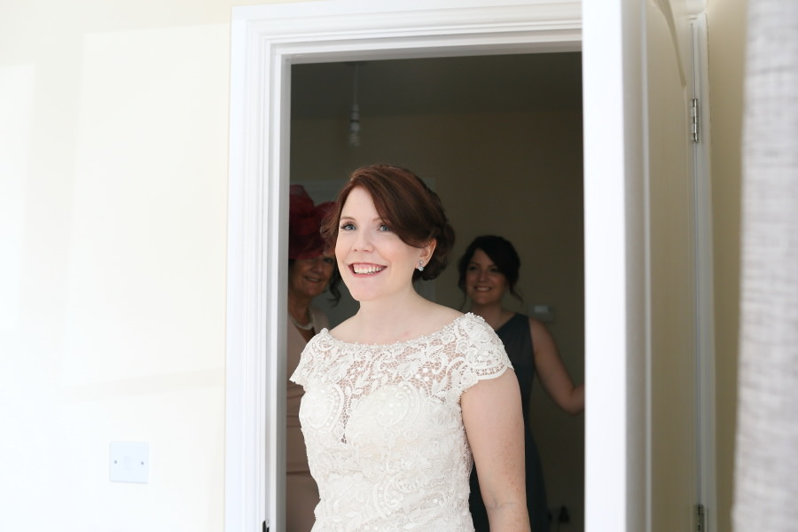 brautiful bride seeing her father for the first time, suffolk wedding photography