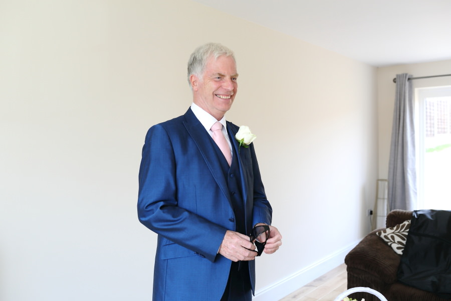 father of the bride seeing daughter for first time, suffolk wedding photography