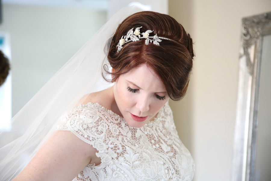 beautiful bride with delicate floral headband , suffolkw edding photography