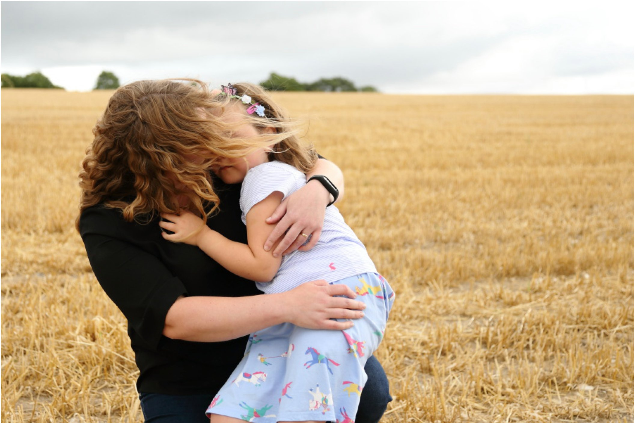 beautiful mum and daughter moment on childrens photography session, in farm field Cambridgeshire