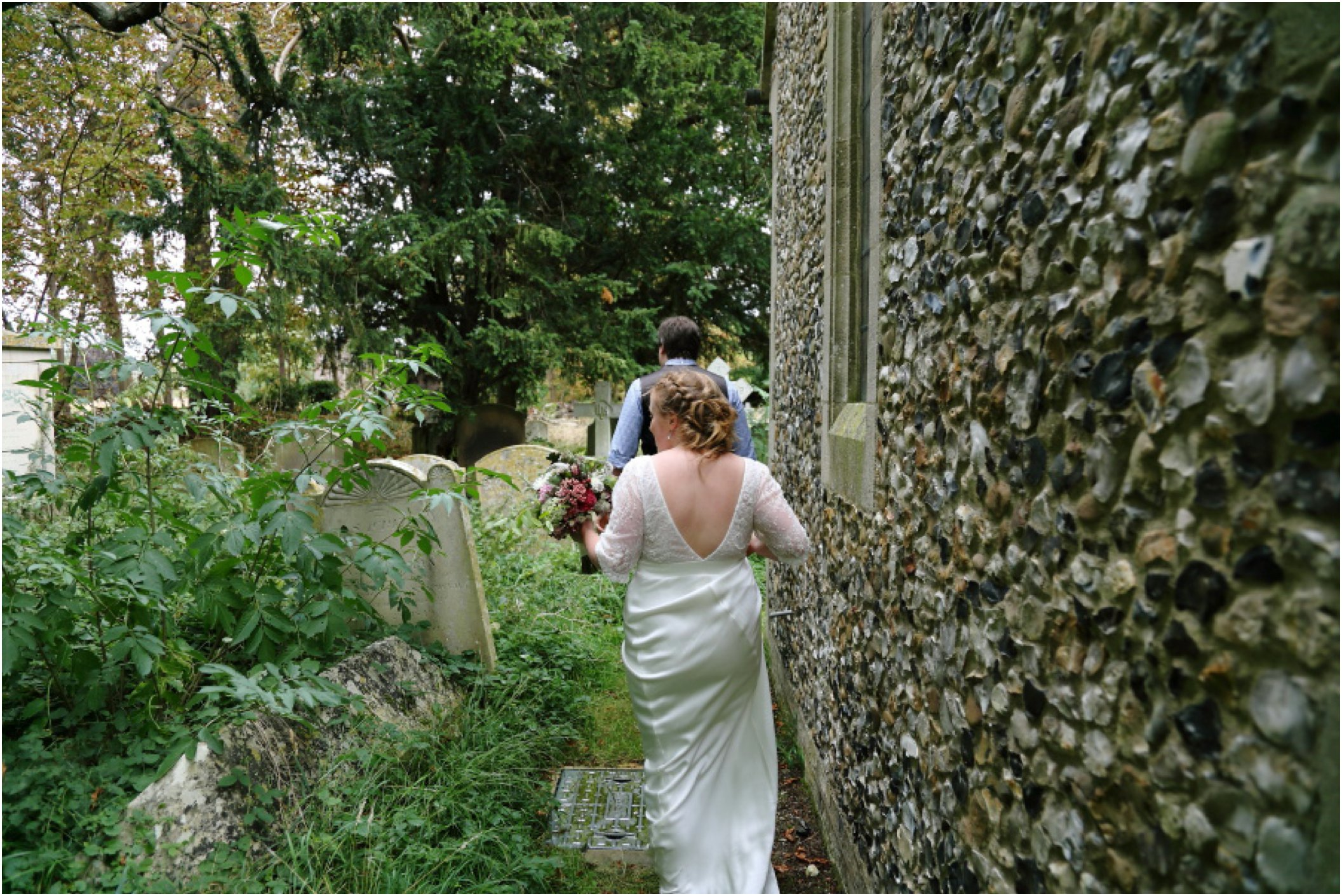 couple walking around church at cambridge wedding