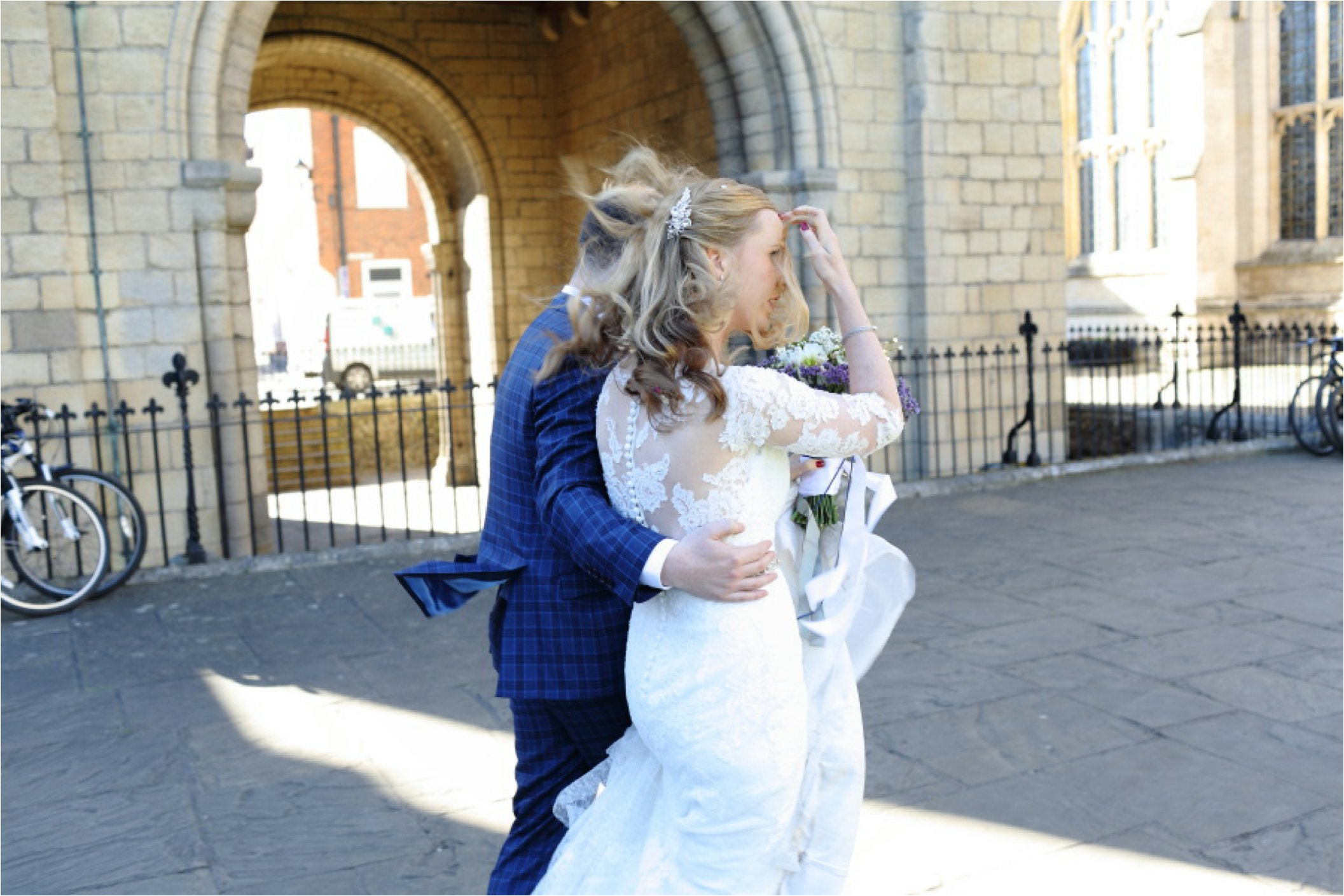 Reportage wedding photography, Bury St Edmunds. Brides hair blowing in the wind