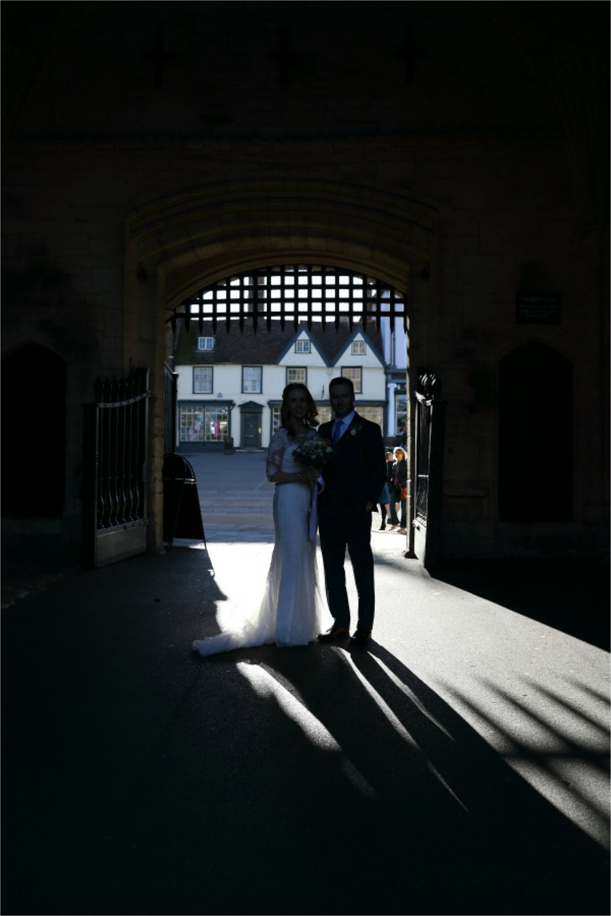 wedding photography in the gates of the abbey gardens bury st edmunds