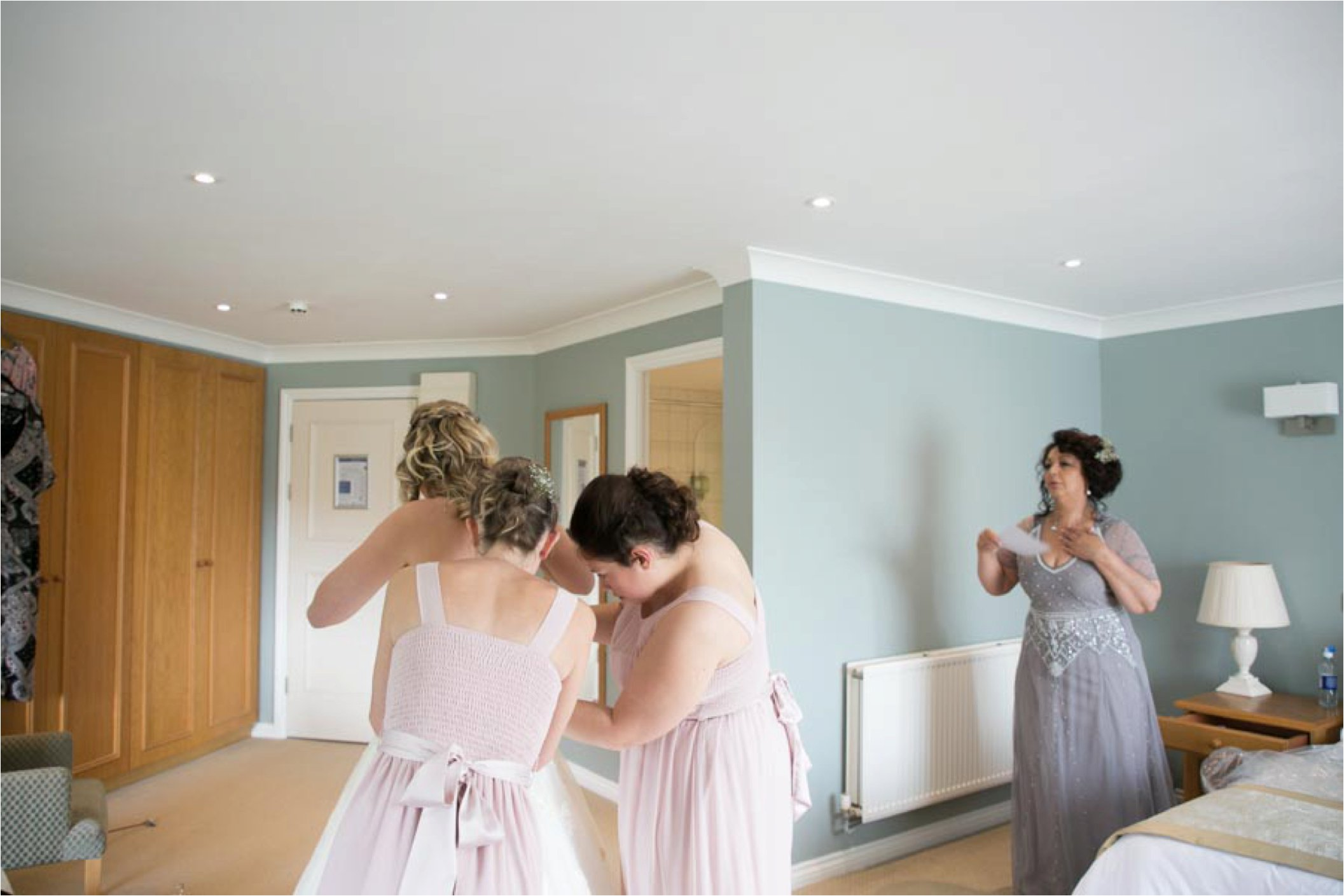 putting wedding dress on at stoke by nayland golf club wedding