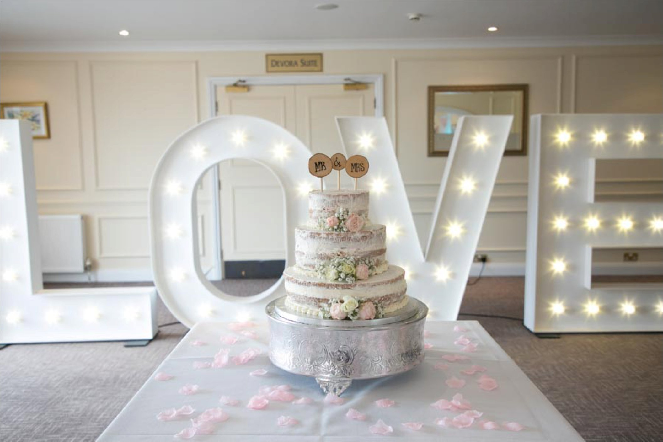 naked cake and giant light up letters