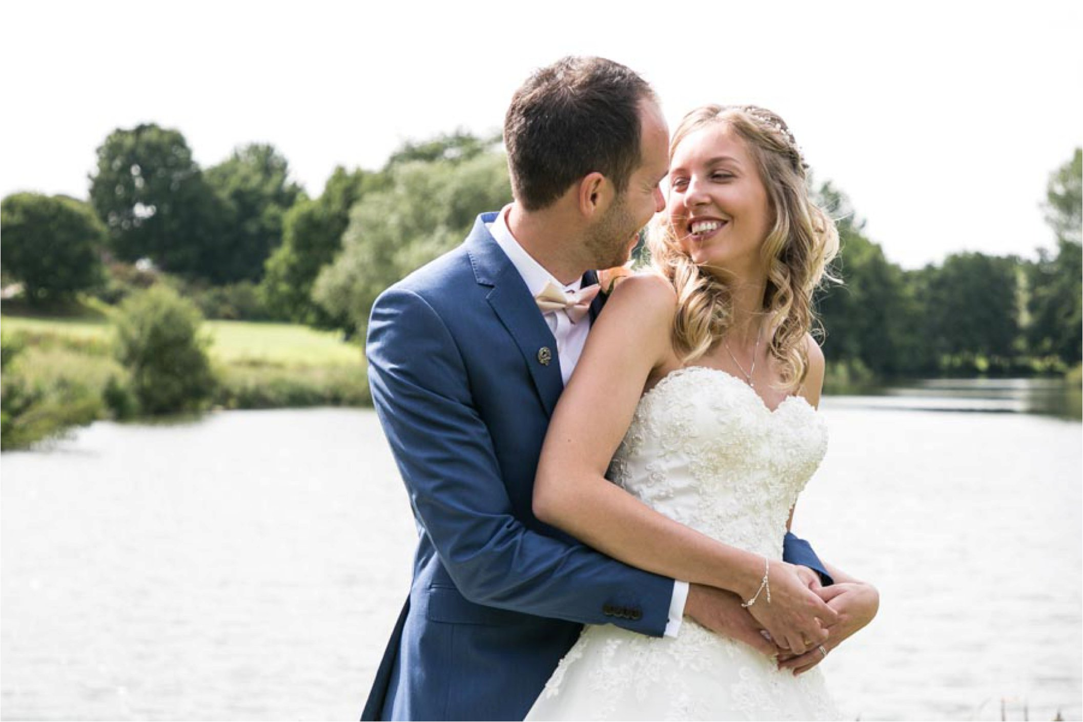 couples photos by the lake at stoke by nayland wedding