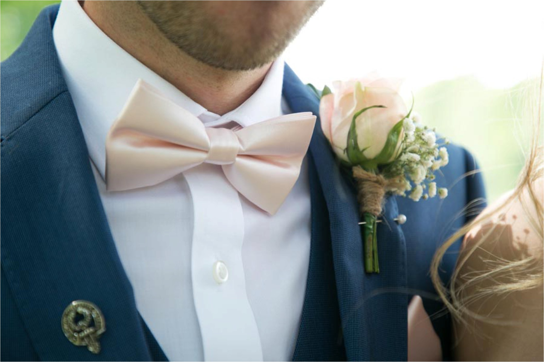 pale pink bow tie on groom