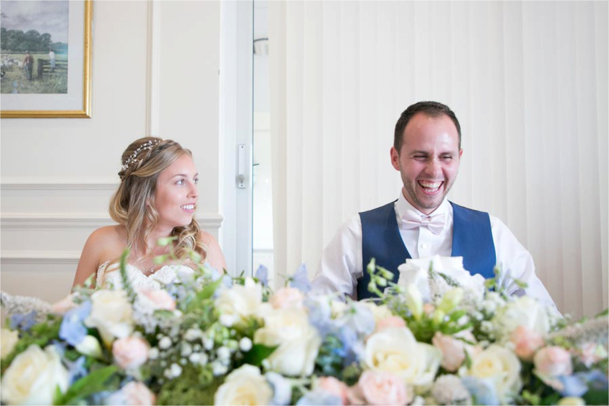 laughing groom at stoke by nayland golf club wedding