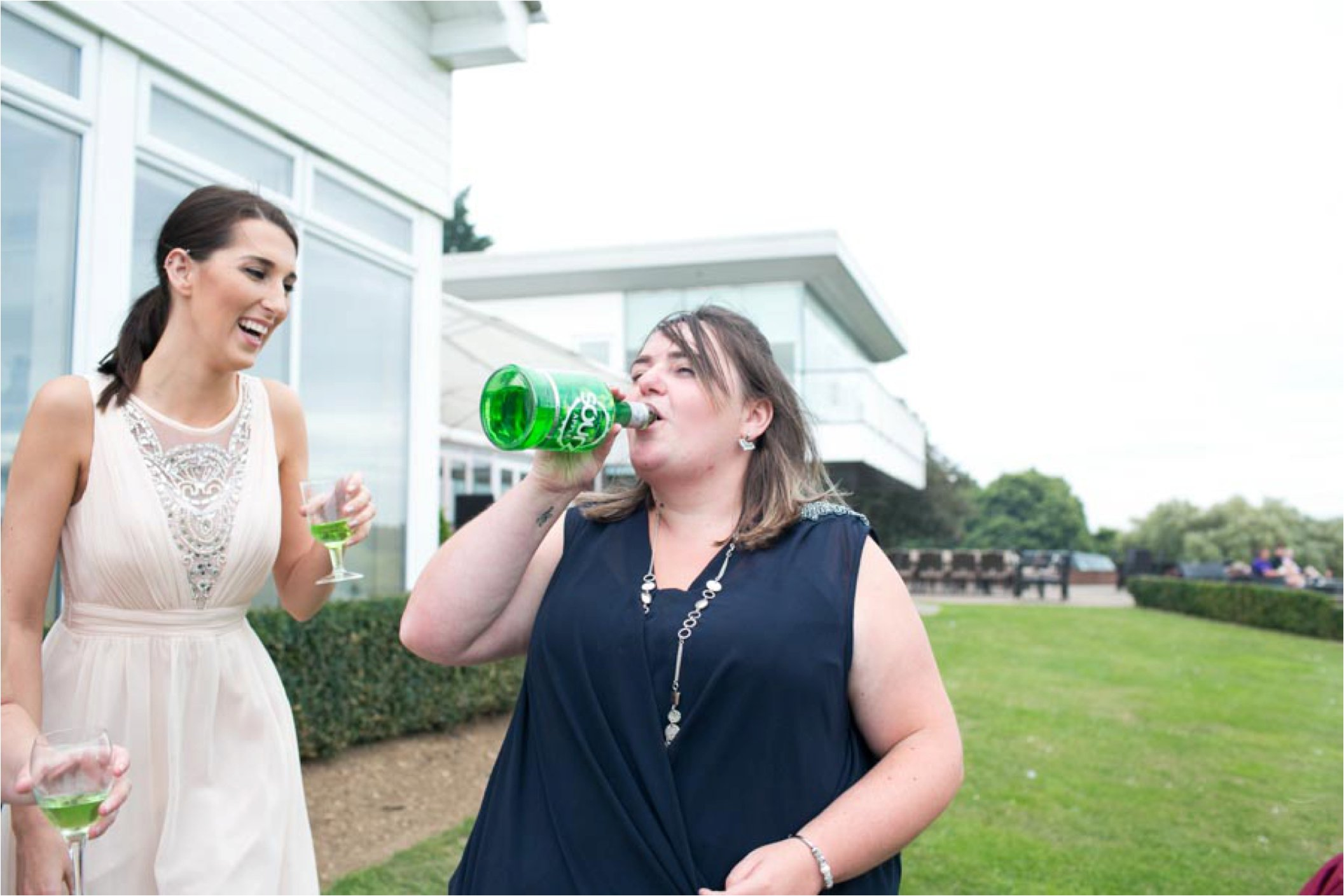 fun drinking shot bridesmaids at wedding stoke by nayland