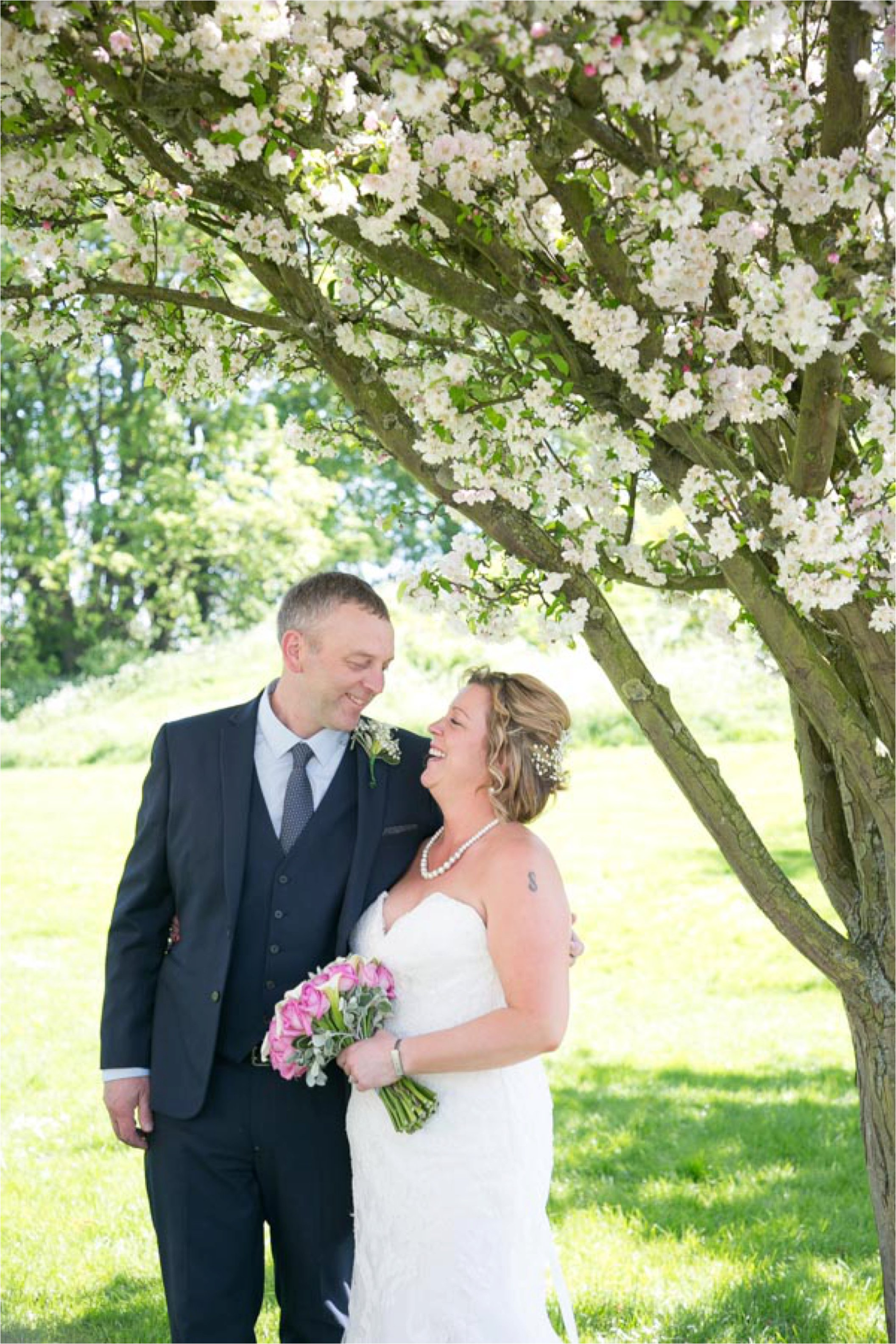 wedding portrait photography in cambridge with blossom in the tree