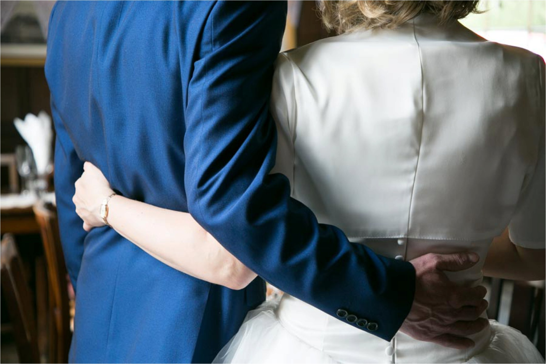 back of couple with arms round each other, bury st edmunds wedding