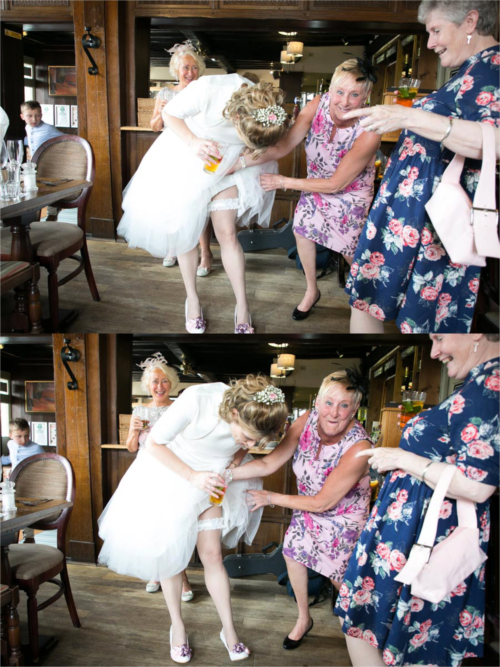 bride and friends looking at her garter, fun wedding photography Bury St Edmunds