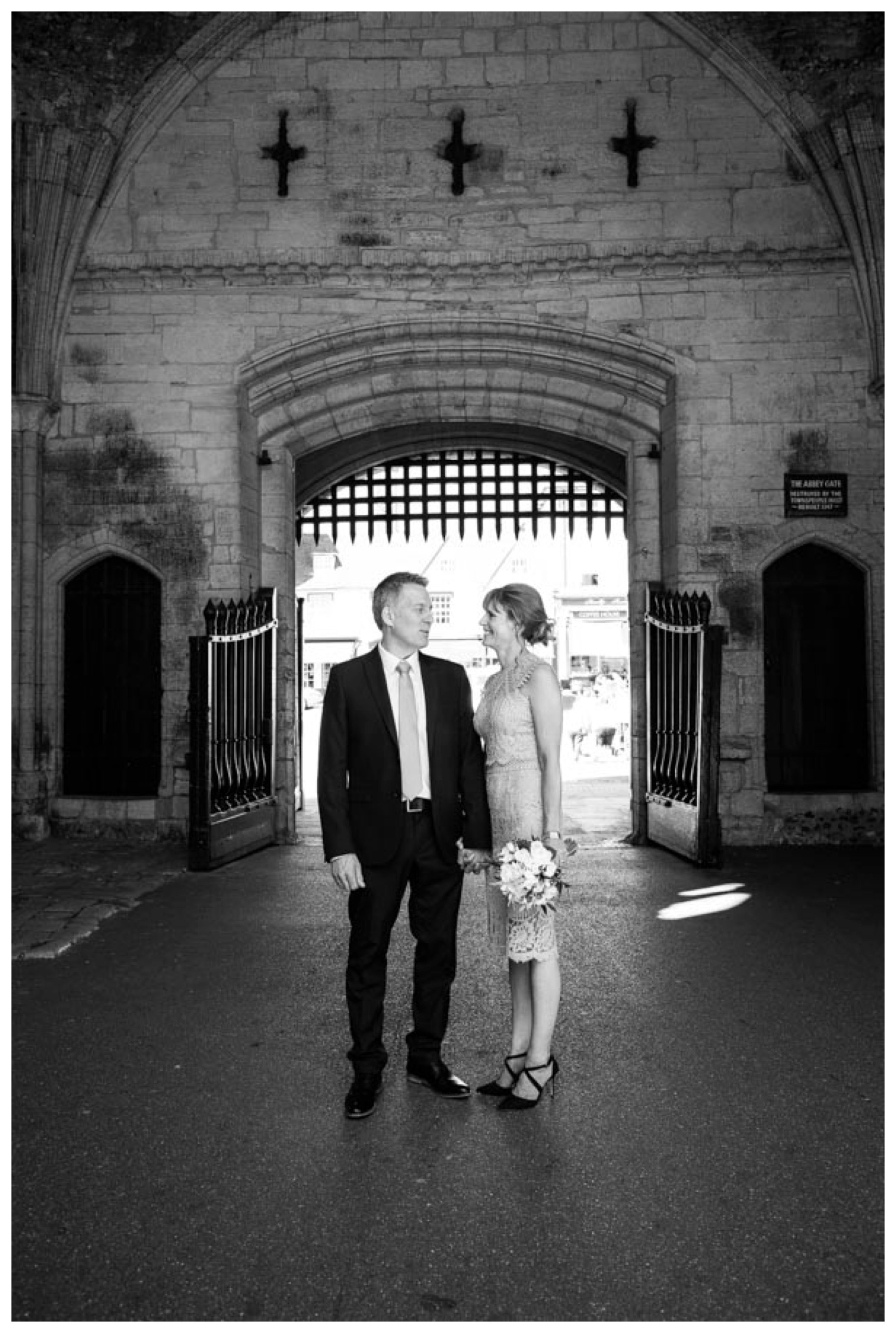 black and white image bride and groom at wedding in abbey gates bury st edmunds