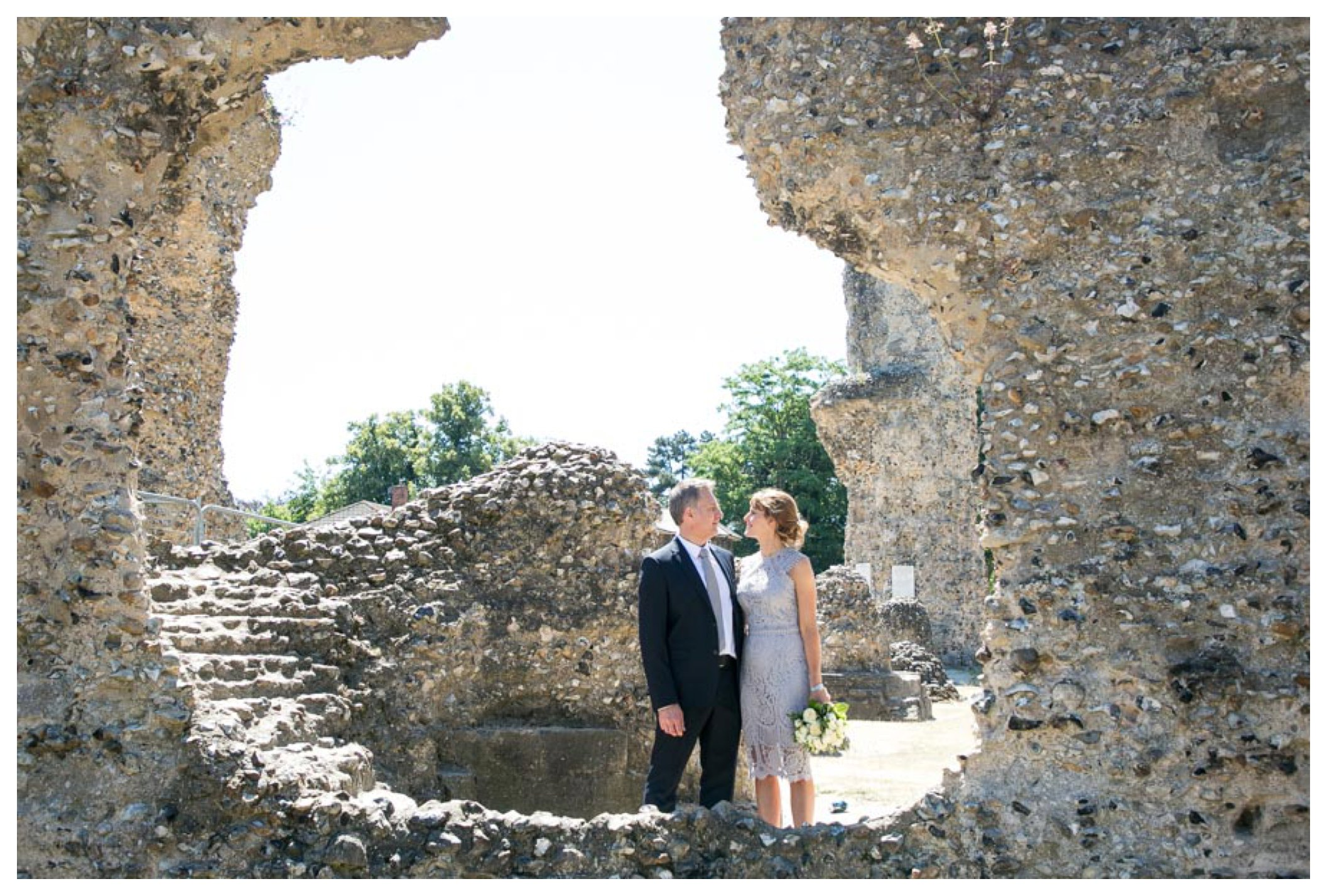 bride and groom standing amongst ruines in Abbey Gardens