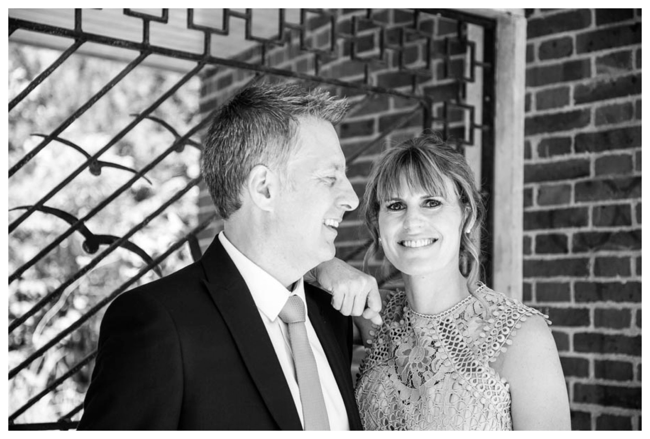 black and white, relaxed bride and groom low key couples portrait