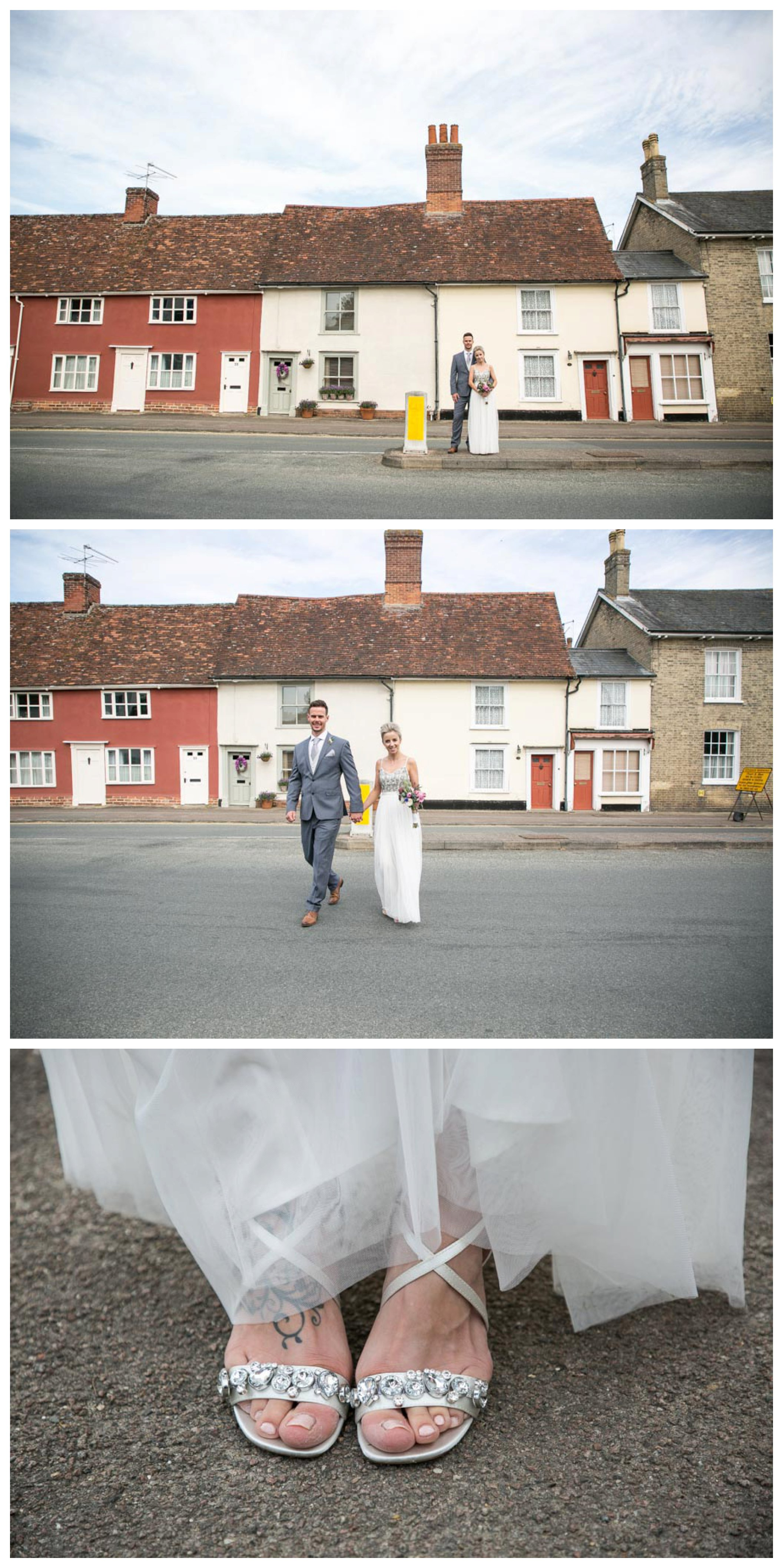 bride and groom in middle of road in Clare sufolkj, walking across the road