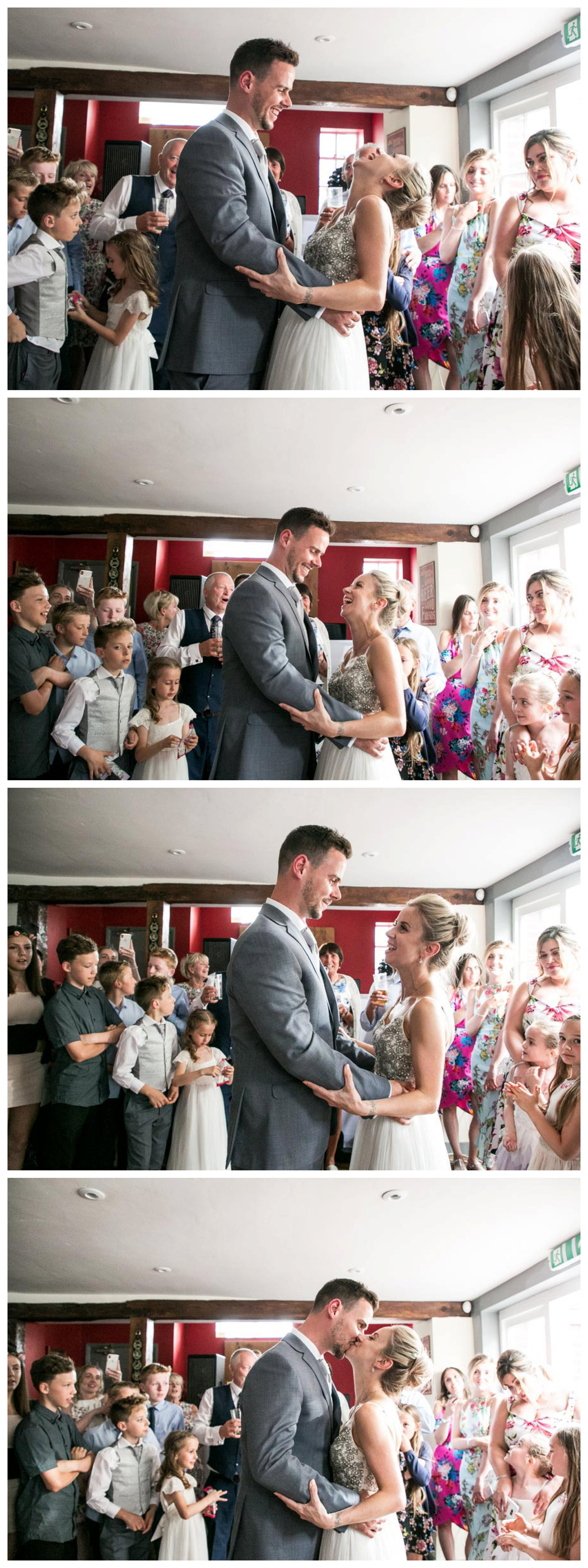 fun laughing as bride and groom have first dance at wedding reception in a pub