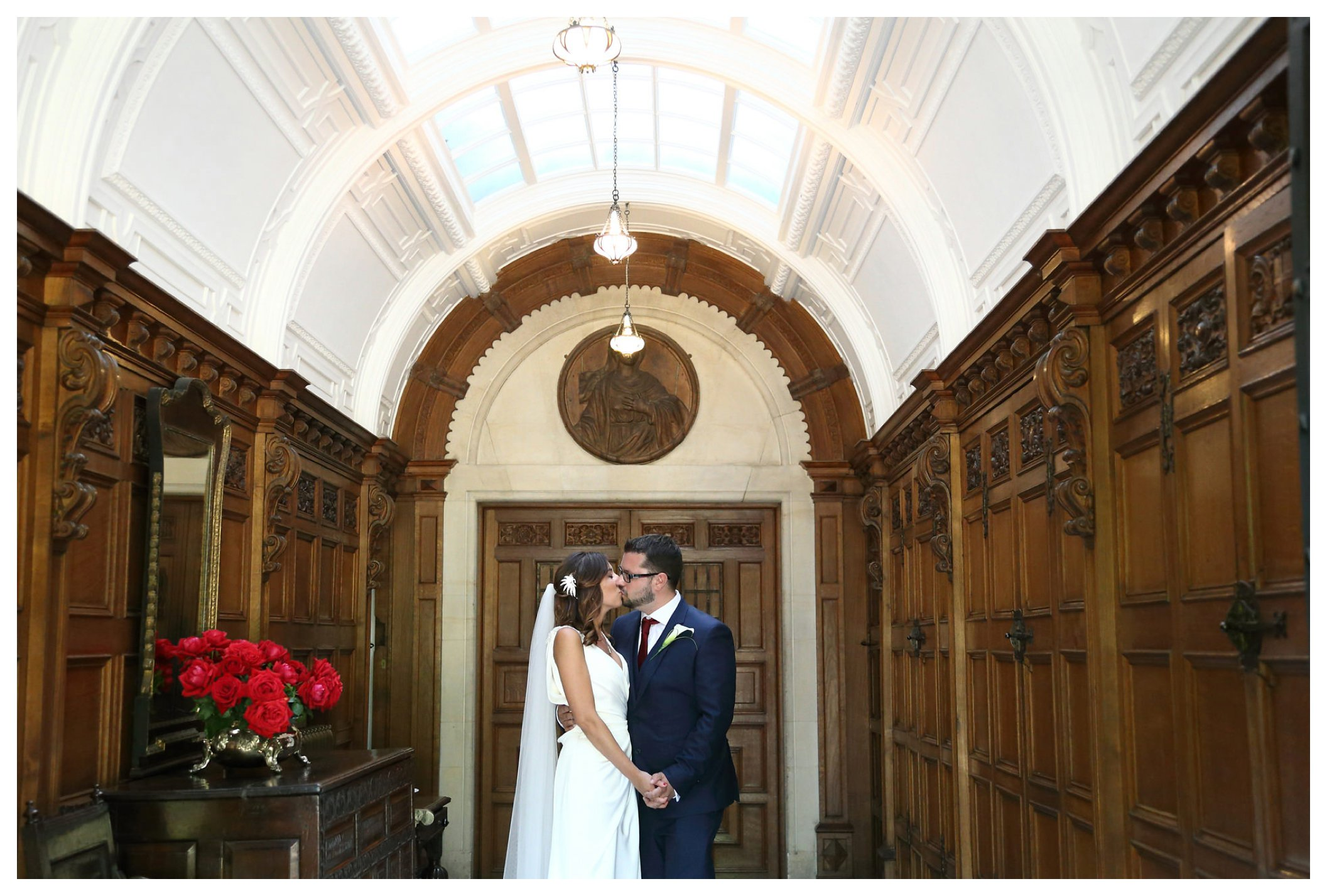 just married couple at Longstoew Hall in Cambridge in hallway