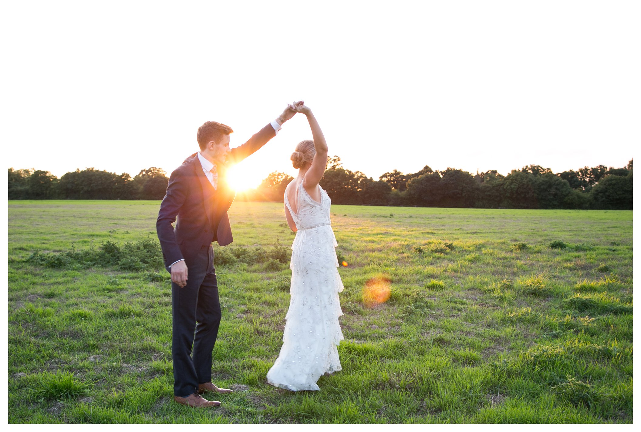bride and groom dancing in the summer evening sun on wedding day