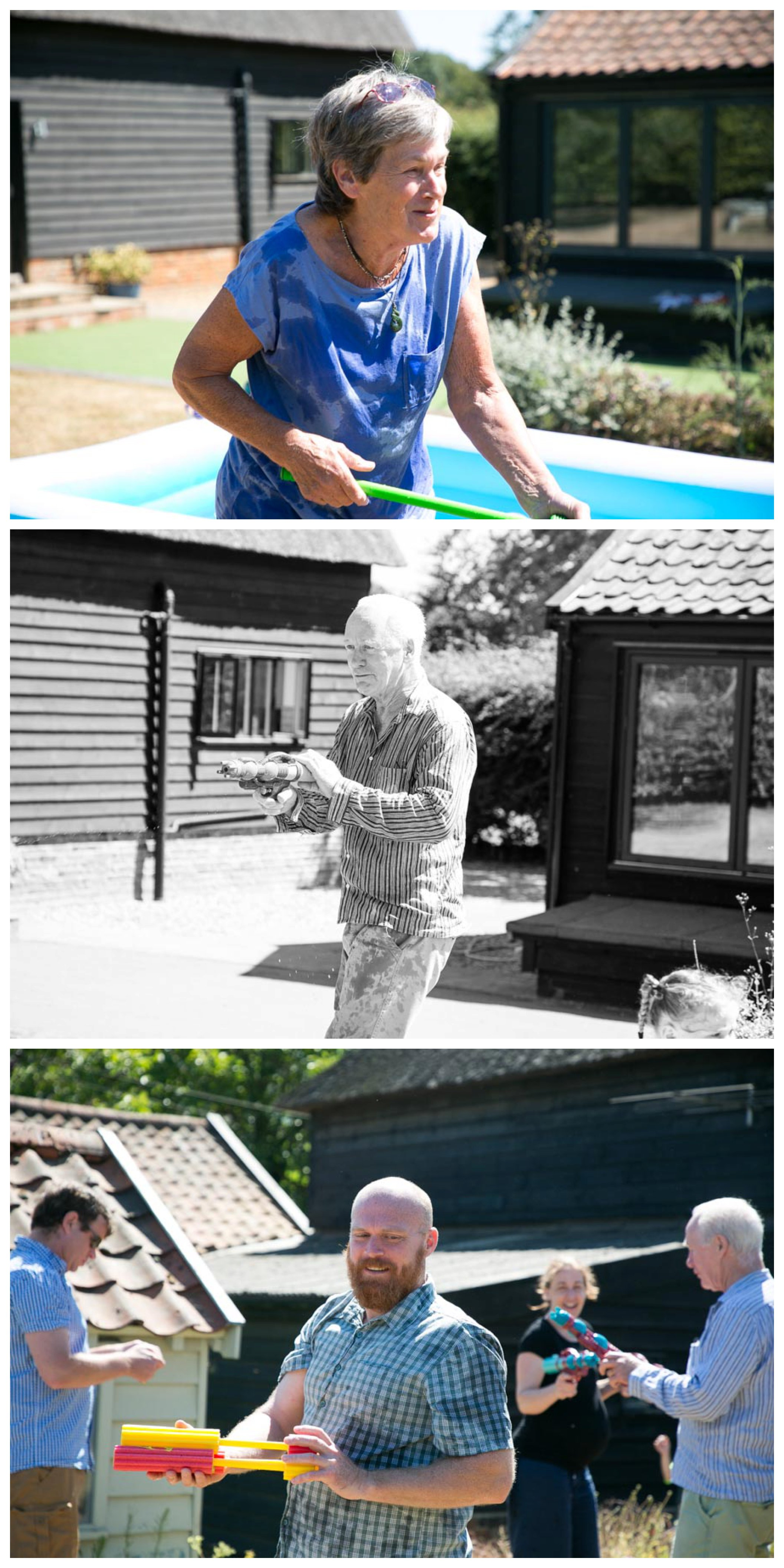 adults having a water fight at summer holiday in suffolk