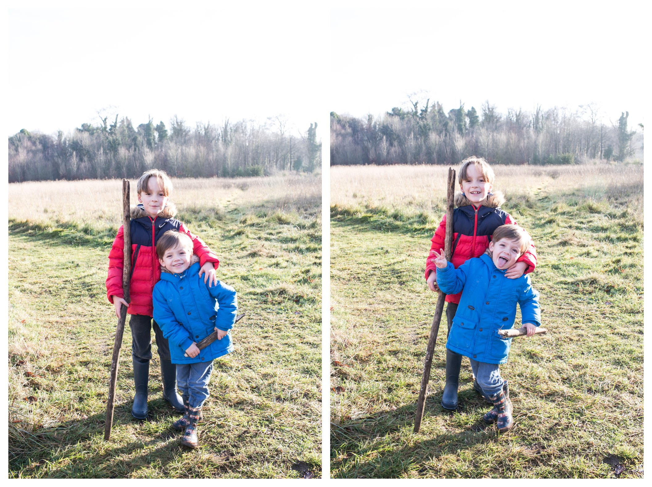 brothers standing together with large stick on country day out