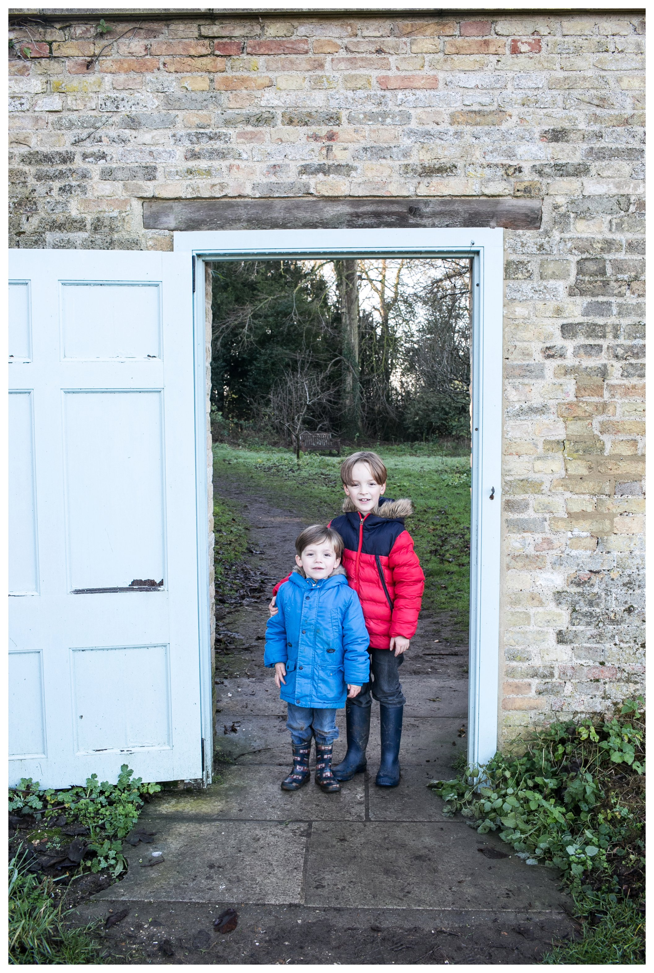 boys in doorway of outdoor wall at wandlebury country park