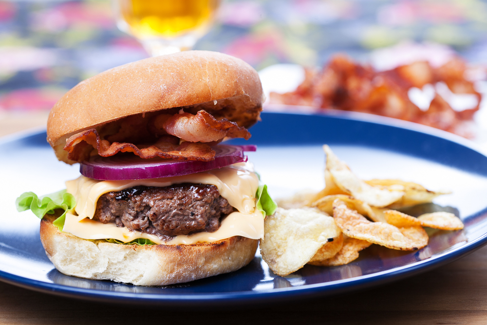 At the heart of it: Bacon burger and beer photographed by David Carlbom, Flickr, CC license.