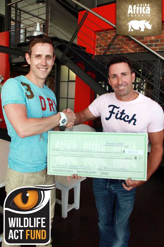 Wildlife ACT receives a cheque from Rhino Africa MD David Ryan