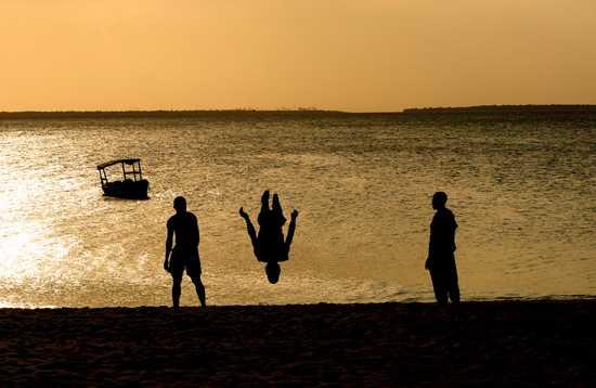 Kids jumping at sunset - Zanzibar