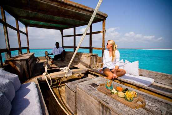 Catching a ride on a traditional dhow at Mnemba Island Lodge