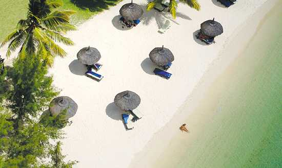 Work on your tan on a beach in Mauritius