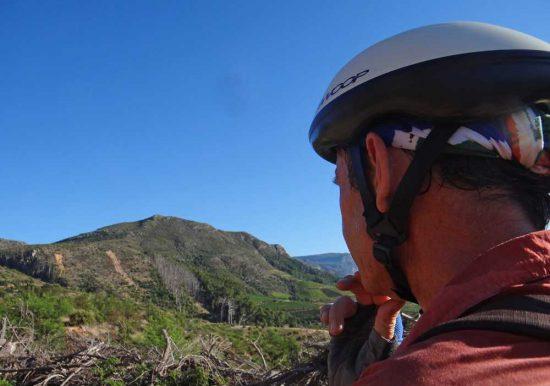 A fellow mountain biker plots his path...