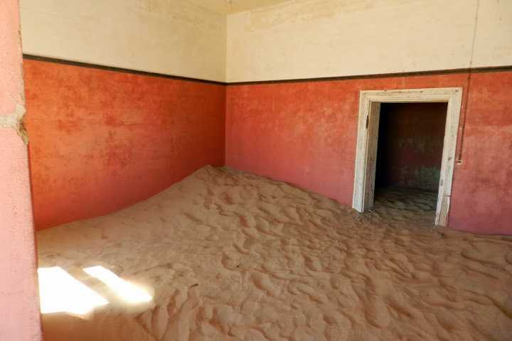 """Abandoned houses inKolmanskop, near Luderitz. """"The elegant houses are being demolished by the wind, and the desert is gradually reclaiming the land."""""""