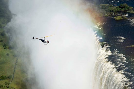 Helicopter flying above Victoria Falls