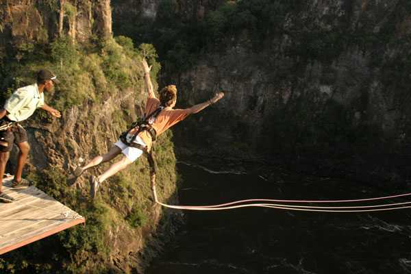 Man bungee jumping in Victoria Falls