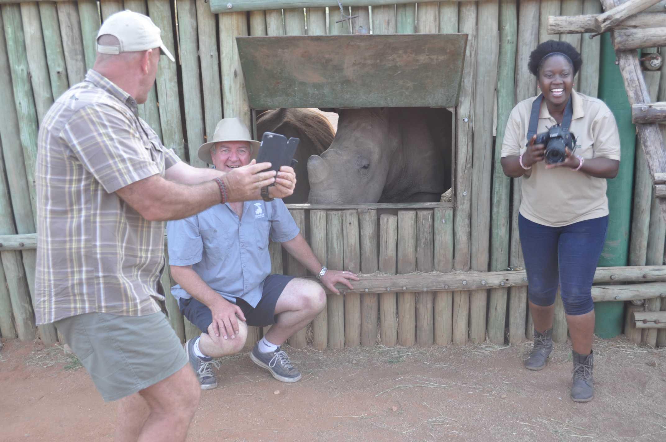 photographer with rhino