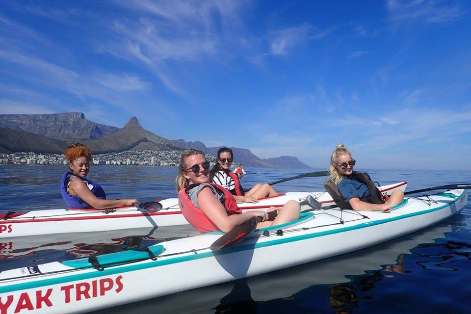 Girls in kayaks in Cape Town ocean