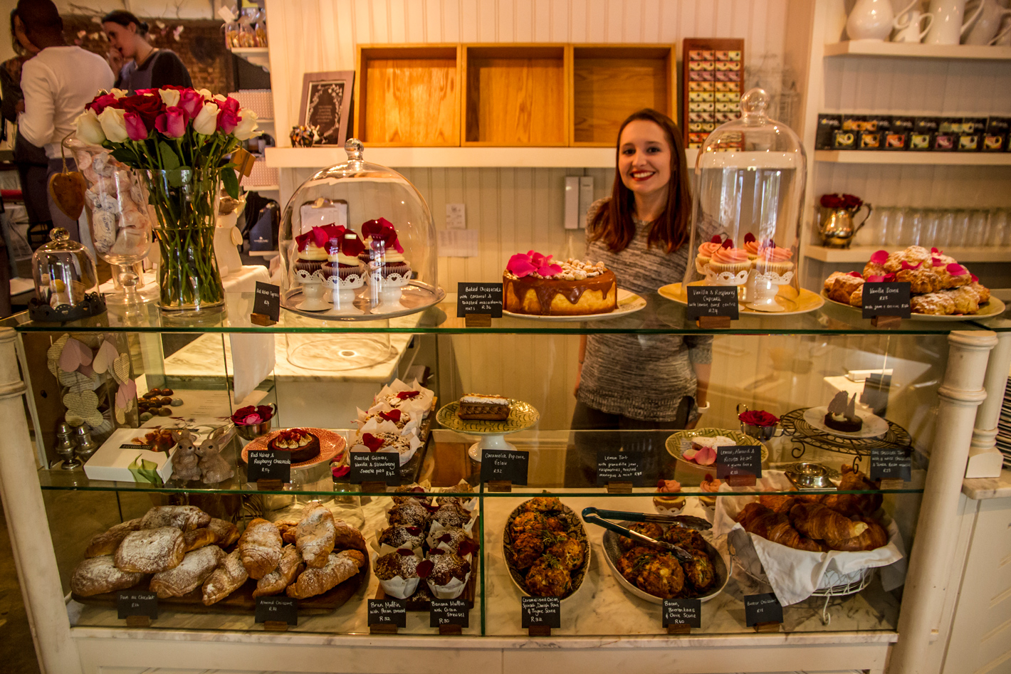 Friendly staff behind cake counter at Four and Twenty in Wynberg