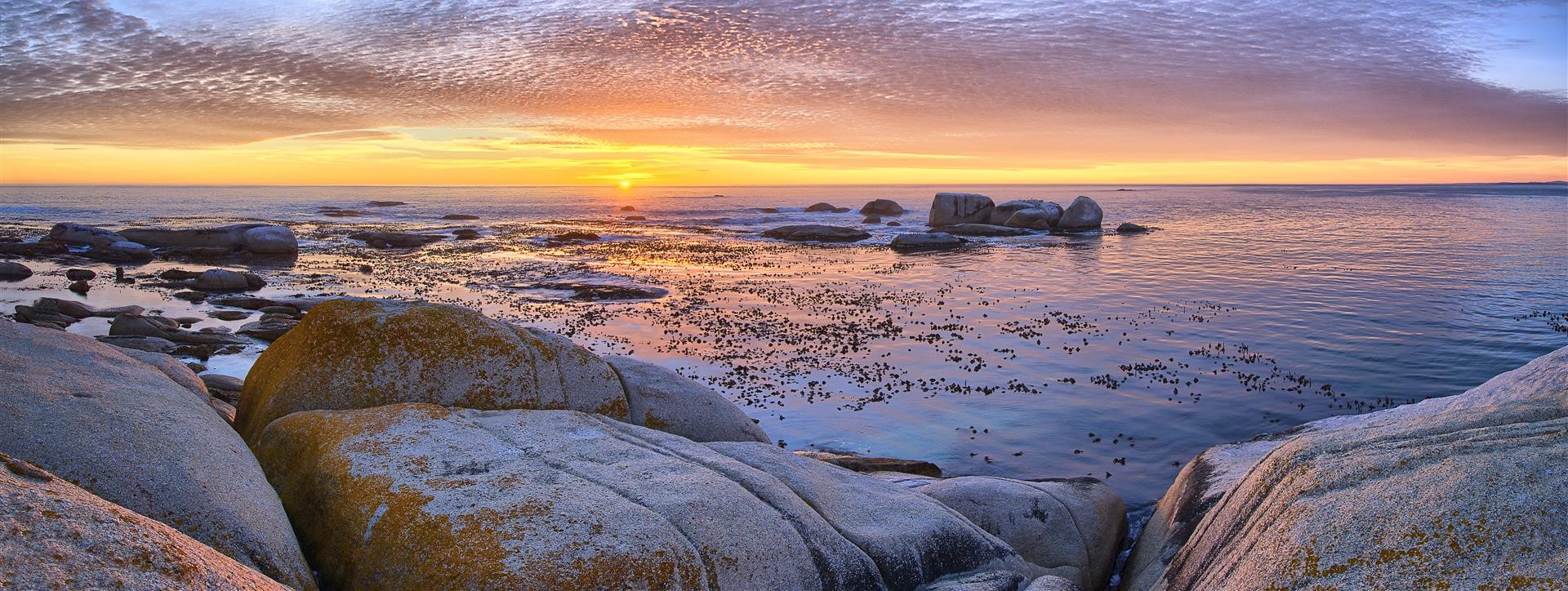 sunset-image-taken-at-camps-bay-beach-with-rocks-south-africa
